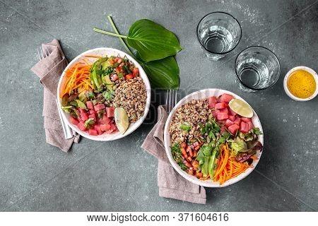 Tuna Poke Bowl With Quinoa And Vegetales. Budda Bowl. Quinua Tuna Salad On Gray Background