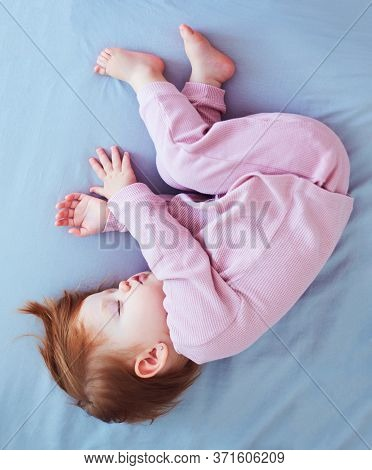 Cute Infant Baby Girl Sleeps Peacefully On The Bed