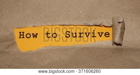 How To Survive Words Written Under Torn Paper. Surviving In Crisis Business Concept
