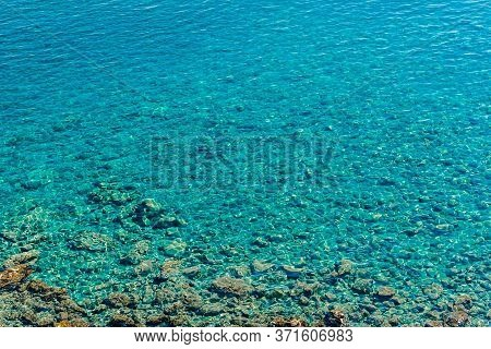 Clear Azure Water Of The Adriatic Sea Near The Shore. Arial View Of The Coast. Azure Sea Background.