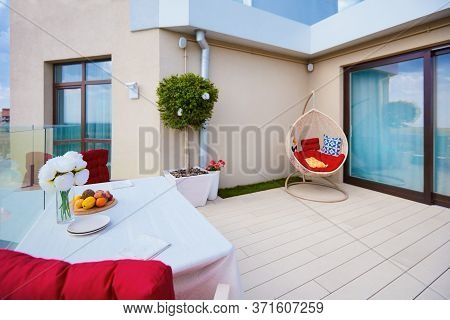 Rooftop Patio Zone Of Penthouse With Decking