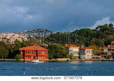 Beautiful And Luxurious Mansions And Houses Over The Hills At The Shore Of Bosphorus Strait And A Bo