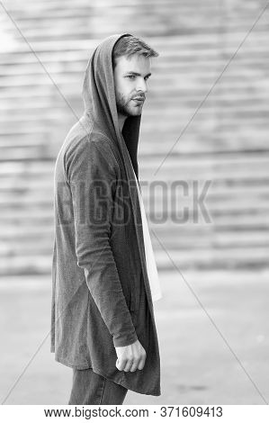 Informal Style Clothing. Fashionable Young Model Man. Mystery Man Posing With Hoodie. Young Street M