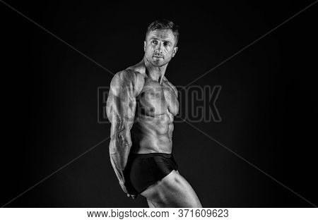 Gym Is My Second Home. Fit Man Black Background. Fit Athlete Show Muscles. Strong Sportsman With Fit