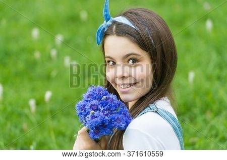 Get Flowers For Womens Day. Happy Girl Hold Cornflowers Outdoors. Floral Shop. Celebrating Womens Da