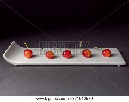 Organic Fruits Of The Cherries On A Rectangular Plate For Sushi.