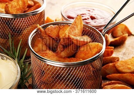 Baked Potato Wedges. Homemade Organic Vegetable Vegan Vegetarian Potato Wedges Snack Fast Food.