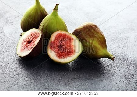 Fresh Figs. Fruit With Half And Hole Figs On Vintage Background.