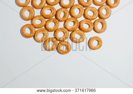 High Angle Of Many Palatable Brown Bagels As Kind Of Fresh Bakery And Fast Food On White Background