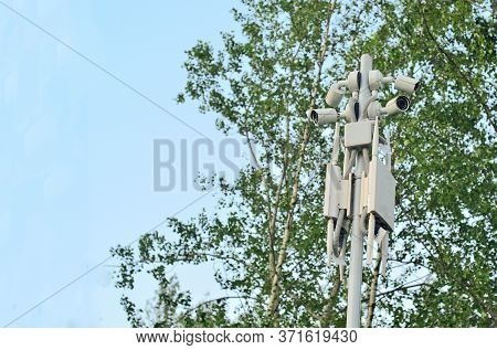 Several Cctv Cameras On A Mast In The Park.security System, Copyspace.