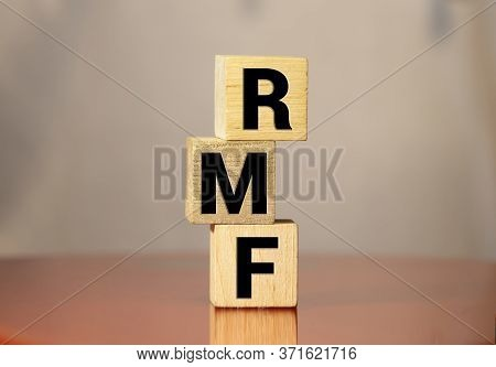Wood Block Word Rmf And Coins With Copy Space Using As Background Business Financial, Saving Money,