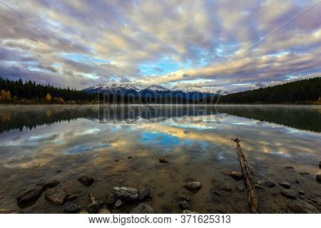 Majestic lake Patricia at sunrise.Jasper National Park. Rocky Mountains of Canada. The concept of active, northern and photo tourism