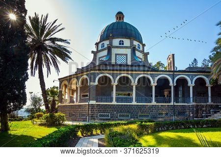 Catholic Church of the Beatitudes of the Franciscan monastery. The Mount Bliss on the Sea of Galilee. Blooming huge park around the monastery. Israel. The concept of religious pilgrimage