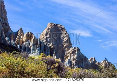 The Clay Cliffs are natural formations of land. Ridges separated by narrow ravines. New Zealand, South Island. The concept of exotic, extreme, natural and photo tourism