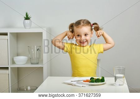 The Child Demonstrates How Strong She Is After Eating Broccoli. Super Power Broccoli, Healthy Baby,