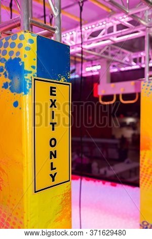 Exit Only Yellow Sign In Indoor Amusement Center