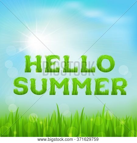 Hello Summer Inscription Made Of Grass. Summer Background With Fresh Green Grass On Blurred Soft Bac