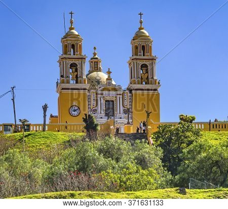 Cholula, Puebla, Mexico - January 5, 2019 Colorful Yellow Facade Iglesia De Nuestra Senora De Los Re