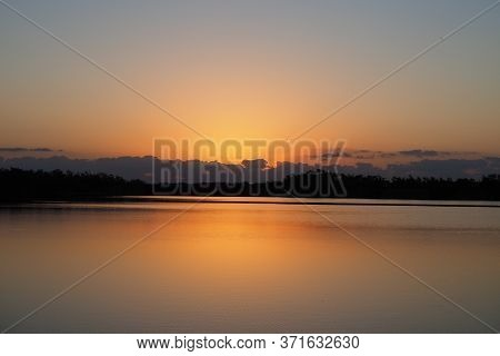 Sunrise Over Tranquil Water Of Nine Mile Pond In Everglades National Park, Florida On Calm Clear Mor