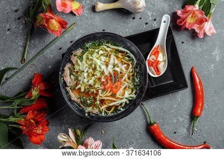 Asian Cuisine, Beef Soup Fo In A Black Plate On A Dark Background. Soup Fo With Beef Broth, Beef Ten