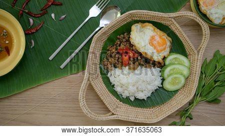 Thai Traditional Food, Stir Fried Minced Pork With Basil (pad Ka Prao), Rice Fried Egg Serving On Wi
