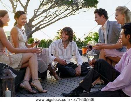 Friends sitting on porch Drinking and socialising
