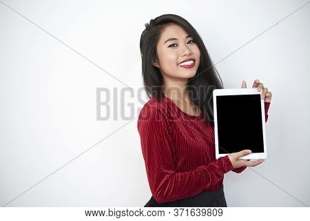 Young Asian Woman Demonstrating Modern Digital Tablet, Looking At Camera Smiling, White Background S