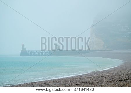 The Lighthouses That Form A Beacon In The Port Of Fecamp, Normandy, France On A Grey And Misty Day