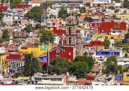 Cholula, Puebla, Mexico - January 5, 2019 Overlook Colorful Red Church Overlook Cityscape Restaurant