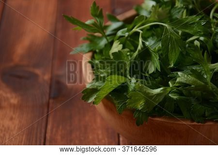 Parsley Bunch In A Bowl On Wood Table Background. Fresh Parsley On Wooden Background. Organic Parsle