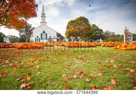West Yarmouth Usa - October 17 2014; Pumpkin Patch Pumpkin Sale Outside White Traditional Church In