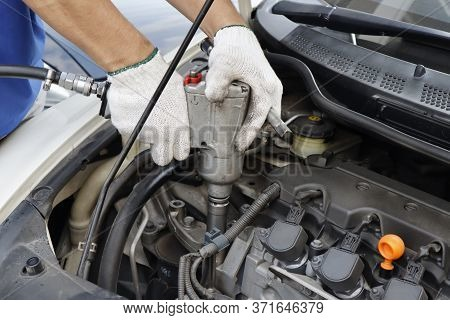 Hand Of Mechanic With Hand Of Mechanic With Wrench Torque To Tightening Bolt  Torque To Tightening B