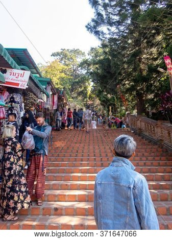 Chiang Mai Thailand-12 January 2020:wat Phra That Doi Suthep Temple,tourists Walking Up And Down Sta