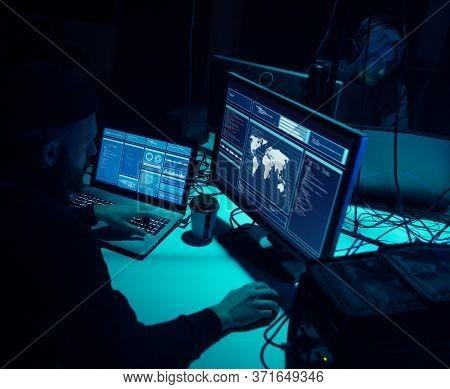 Internet fraud, darknet, data thiefs, cybercrime concept. Hacker attack on government server. Dangerous criminals coding virus programs.