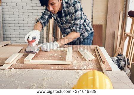 Carpenter Man Is Working Timber Woodworking In Carpentry Workshops, Craftsman Is Using Sander Machin