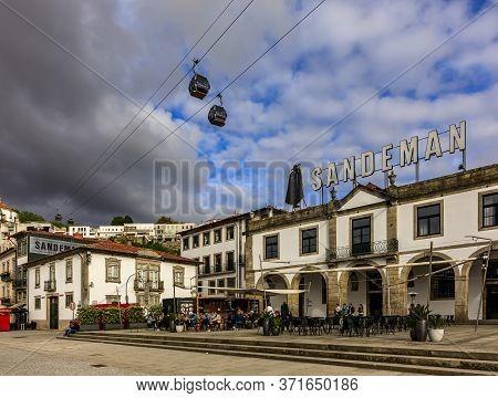 Gaia, Portugal - May 31, 2018: Sandeman Cellar In The Historic Centre Of Vilanova De Gaia, Portugal.