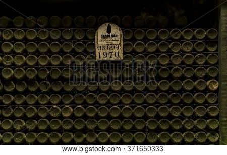 Porto, Portugal - May 31, 2018: Dusty Bottles Of Rare Vintage Port Wine Stored At Sandeman Cellar, P