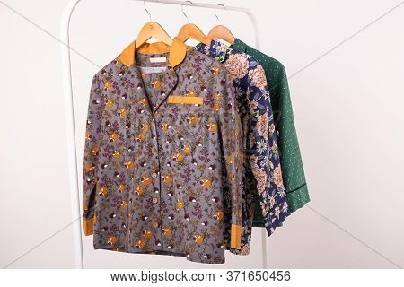 Clothing Retails Concept. Ladies Pajamas On Hangers In Clothes Store. Pajama In Shop. Advertise, Sal