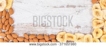 Frame Of Almonds And Banana Chips As Source Carbohydrates, Dietary Fiber, Vitamins And Minerals, Con