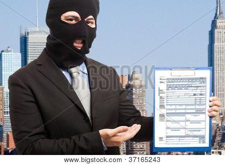 Thief businessman showing a document