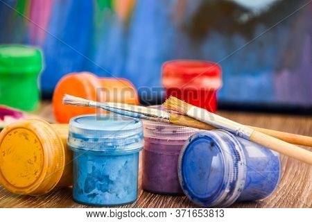 A Set Of Paints For Body Painting. Workplace, Paints, Brushes And Palette On The Colorful Background