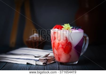 Panna-cotta, Dessert. Jelly, Whipped Cream Pudding Of Berries And Gelatin. A Cupcake, A Rough Cloth