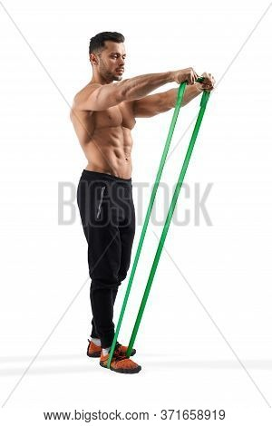 Full Length Portrait Of Muscular Shirtless Bodybuilder Training Shoulders With Fitness Resistance Ba