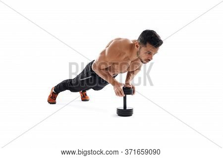 Muscular Shirtless Fit Man Building Muscles On Floor Using One Dumbbell, Isolated On White Studio Ba