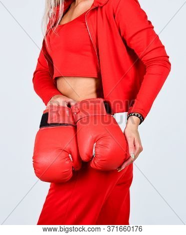 Never Give Up And Keep Moving. Sports Woman In Tracksuit And Boxing Gloves. Fit Boxer Woman. Kick Of