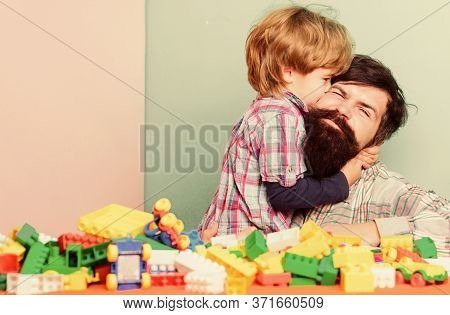 Father And Son Have Fun With Bricks. Child Development And Upbringing. Bearded Hipster And Boy Play