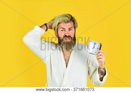 Noise Of Alarm Clock. Man Awake With Alarm Clock Ringing. Guy In Bathrobe. Circadian Rhythms Are Big
