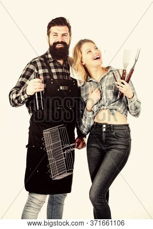 Bearded Hipster And Girl Ready For Barbecue Party. Roasting And Grilling Food. Cooking Together. Cou