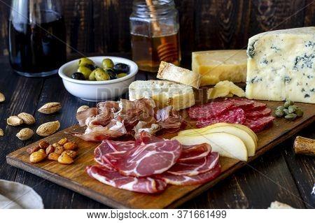 Wine Snack. Prosciutto, Parma Ham, Salami, Almonds, Olives, Baguette, Blue Cheese, Parmesan. Antipas