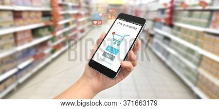Man Hand Holding Smartphone Device And Touching Screen. Online Shopping